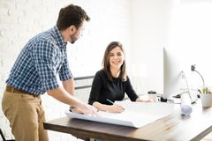 Beautiful female architect with a coworker Stock Image