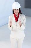 Beautiful female architect wearing a hard hat Royalty Free Stock Photo