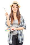 Beautiful female artist holding a paintbrush Stock Photography