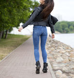 Beautiful female ass in blue jeans Stock Photo