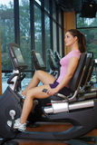 Beautiful Female Athlete on a Cycling Machine (3) Royalty Free Stock Images