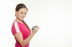 Beautiful female athlete flexing muscles of the hand expanders Stock Photos