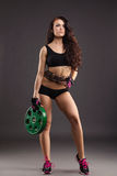 Beautiful female athlete posing with weight disc Stock Image