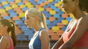 Beautiful female athletes waiting for competition, rivals determined to win stock image