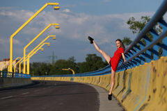 Beautiful female ballet dancer on a bridge royalty free stock photography