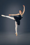 Beautiful female ballet dancer on a grey background. Royalty Free Stock Photos