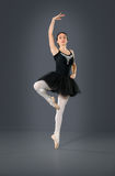 Beautiful female ballet dancer on a grey background. Stock Photo