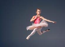 Beautiful female ballet dancer on a grey Stock Photos