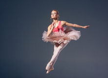 Beautiful female ballet dancer on a grey Royalty Free Stock Photo
