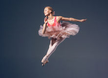 Beautiful female ballet dancer on a grey Royalty Free Stock Images