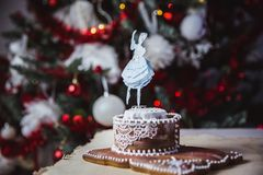 Beautiful female ballet dancer on a music box made from gingerbread with abstract bokeh background stock photo