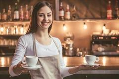 Beautiful female barista Stock Photo