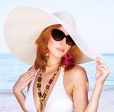 Beautiful female on the beach Stock Image