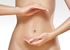Beautiful female belly. Pretty woman cares stomach. Healthcare, digestion, intestinal health. Wellness, spa. Body part. Beautiful female belly. Pretty woman Stock Photos