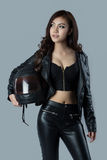 Beautiful female biker wearing a leather jacket Stock Images