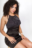 Beautiful female in a black cocktail dress Royalty Free Stock Image