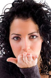 Beautiful female blowing a kiss Stock Photography