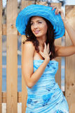 Beautiful female in blue lady's hat Stock Photo