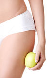 Beautiful female body and apple Royalty Free Stock Images
