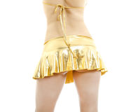 Beautiful female body back ass in golden skirt. Stock Photos