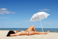Beautiful female body on the beach Stock Images
