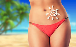 Beautiful female body on the beach Stock Photography