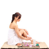 Beautiful female body legs with cosmetic container bowl and cream Stock Photos