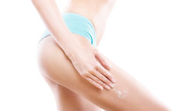 Beautiful female body with lotion Stock Photos