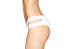 Beautiful female body. in white swimming panties stock photo