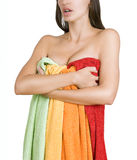 Beautiful female body wrapped in multicolored towels (color laun Royalty Free Stock Photography