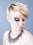 Beautiful female with bright impudent make up Stock Photo