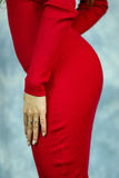 Beautiful female buttock. Detail of Beautiful female buttock in red dress stock image