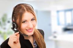 Beautiful female call center operator Stock Images