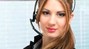 Beautiful female call center operator Stock Photo