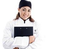 Beautiful female chef holding notepad Royalty Free Stock Image