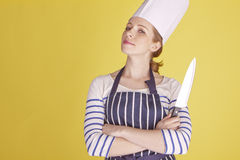 Beautiful female chef. royalty free stock photography
