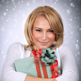 Beautiful female with Christmas gift Royalty Free Stock Photos
