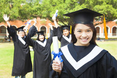 Beautiful female college graduate holding a diploma at ceremony Royalty Free Stock Photos