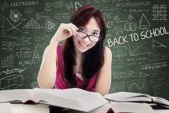 Beautiful female college student in class Royalty Free Stock Photos