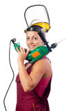 Beautiful female construction worker with drilling Stock Image