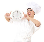 Beautiful female cook holding a big clock Royalty Free Stock Photos