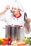 Beautiful female cook tasting soup Stock Photos