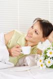 Beautiful female with cup Royalty Free Stock Photography