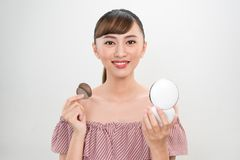 Beautiful Female With Cushion Puff And Mirror Applying Makeup Powder Foundation.  royalty free stock photo