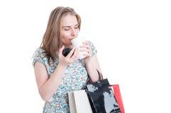 Beautiful female customer enjoying a fresh coffee Royalty Free Stock Photo