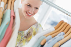 Beautiful female customer selecting clothes at store Stock Photography