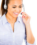 beautiful female customer service representative or operator or help desk support staff wearing a head set Stock Photos