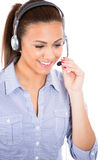 Beautiful female customer service representative or operator or help desk support staff wearing a head set Royalty Free Stock Images
