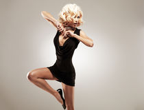Beautiful female dancer  in black dress Stock Photos