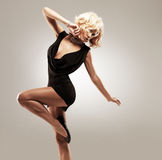Beautiful female dancer  in black dress Stock Images